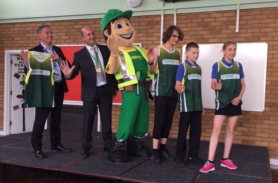 presentation of running vests at The Priory School