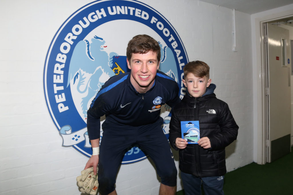 Conor O'Malley presents vouchers to shootout winner